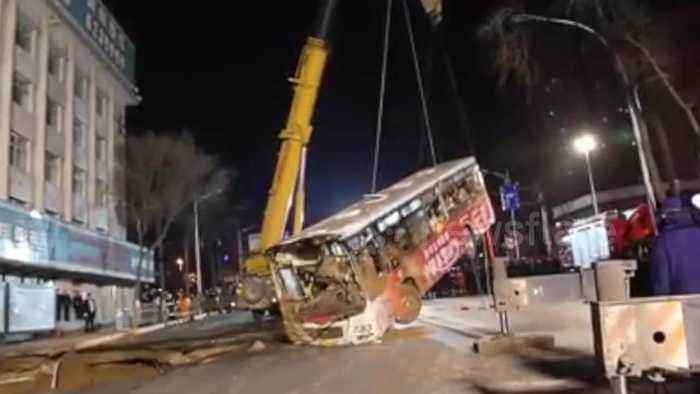 2001131700-Nine-people-killed-after-sinkhole-swallows-bus-while